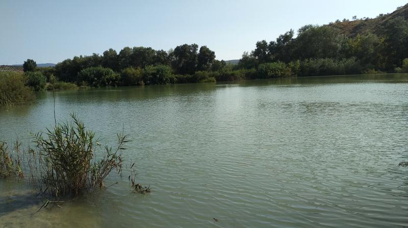 GR 249.3. Variant Stage 2. One of the lagoons of the meander of the Castillejos in charge